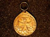 Ring und Medaille