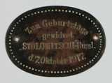 Ovale Metallmarke als Geburtstagsgeschenk