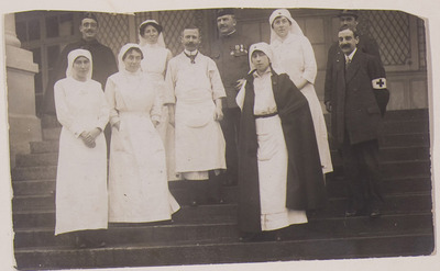 Photo of a Field Hospital and medical staff; a postcard of her colleagues sent home by Louisa Greamy