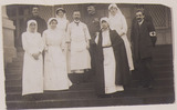Group photograph of the MacDougald family, and nursing photograph sent home by Louisa Greamy