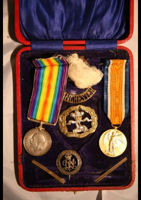 Collection of medals and shrapnel
