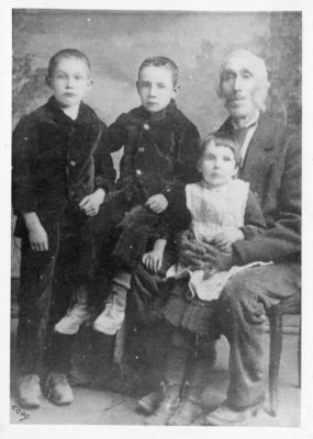 Photo of John J Bourke as a child (small boy seated)