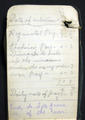 Notebook with a bullet hole held in the top pocket of Pte. Patrick Kane